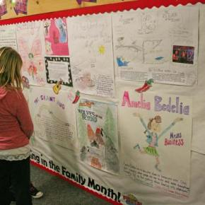 Students and families created posters depicting their favorite books to celebrate Reading in the Family month. Photo by Darla Hussey