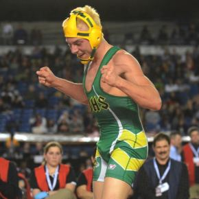 Meritt Fink celebrated his win in the 138-pound division. Photo by Scott Terrell