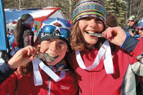 Liv Aspholm, left, and Mariah Lucy proudly display a pair of medals they won during competition at the BC Championships at Kelowna, B.C., last weekend. Both skiers were part of a 29-member Methow Valley Nordic Team that made the trip. Photo by Brooke Lucy