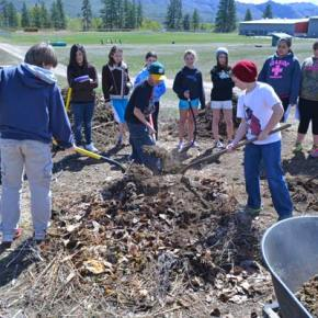 oys shoveling are L-R Isaac Blodgett, Jed McMillan, Caleb Nielson. Around circle Anaka Mines (Exec. Dir. Classroom in Bloom), Stephanie Miranda, Kristy Vieth, Cheyenne Fonda, Maya Schrager (holding hose), Chloe Blum, Isabella Dinsmore, Hailey Dammann, Tommie Ochoa, Shelby White. Photo by Laurelle Walsh