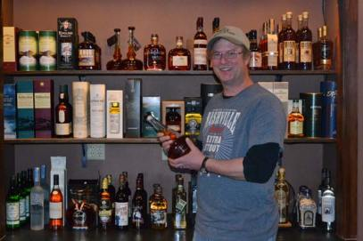 "Dave Swenson displays some of the ""top-shelf"" spirits offered by the Wine Shed. Photo by Laurelle Walsh"