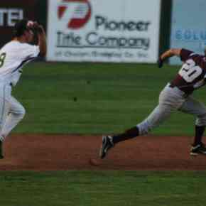 Third baseman Shane Higbee pursues a Kittitas runner caught off base when Higbee fielded a ground ball. Higbee threw to second baseman Riley Calvert, who tagged the Coyote out.Photo by Mike Maltais