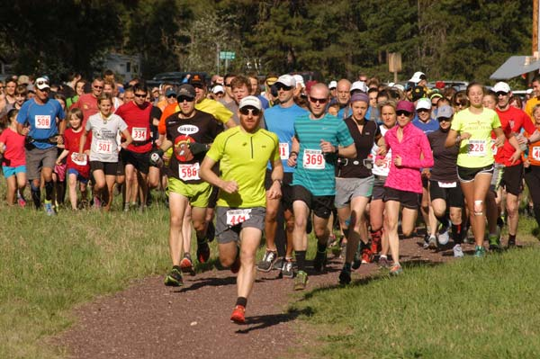 "Brian Gregg (bib No. 444), who competed at the Winter Olympics in Sochi this year, leads the pack at the start of the annual Sunflower Marathon & Relay at the Mazama Corral Trailhead last weekend. Gregg was racing with team ""Chads and their better halves."" At Gregg's elbow is Erik Brooks, wearing bib No. 586, who finished second overall in the individual trail marathon division. Photo by Mike Maltais"