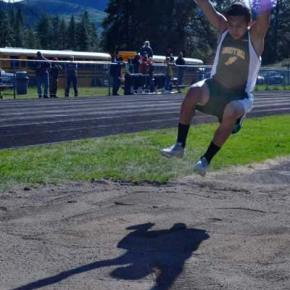 Jose Dominguez and his shadow in the long jump pit. Photo by Laurelle Walsh