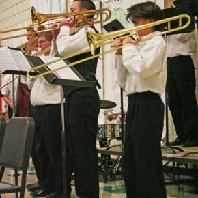 The jazz band trombone section, right to left: Tyler White, Max Johnson, D. J. Haley, Liam Daily. Photo by Darla Hussey