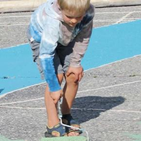 Keller Knab of Winthrop helps paint an art installation by Karin Wimmeder at TwispWorks. Keller had a lot of help from other kids who grabbed rollers. Photo by Don Nelson