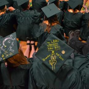 Olivia Bowers and Kelsey Jensen inscribed their mortarboard caps with personal messages.  Photo by Laurelle Walsh