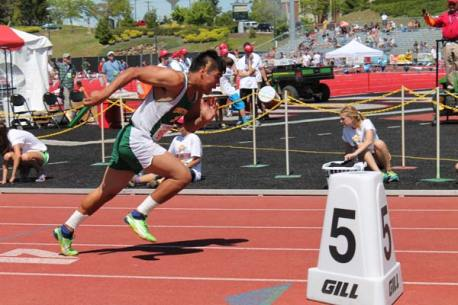 Cesar Dominguez runs in the first leg of the 4x100m relay. Photo by Lauren Fitzmaurice