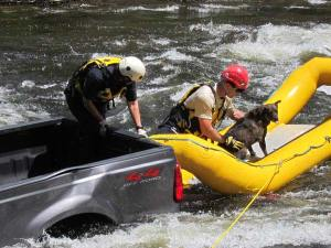 Vikki and Ottis Buzzard get Jessie settled in the rescue raft. Photo by Don Nelson