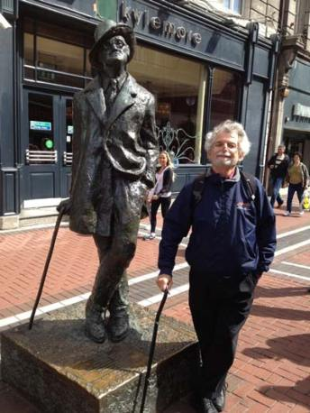 Bill Hottell poses next to a statue of James Joyce in Ireland. >Photo courtesy of Bill Hottell