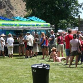 Long lines didn't stop attendees from enjoying the delicious food offered by vendors. Photo by Darla Hussey
