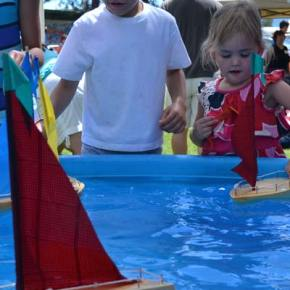 Wooden boat builders launched their craft at the kiddie pool. Photo by Laurelle Walsh