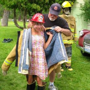 Dick Evans with a future volunteer firefighter. Photo by Pat Leigh