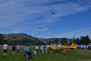 Eight smokejumpers made safe landings on the grassy field. Photo by Laurelle Walsh