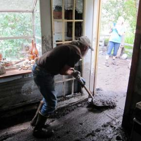 Moving mud out the back door of the Elk/Lewis home. Photo by Don Nelson