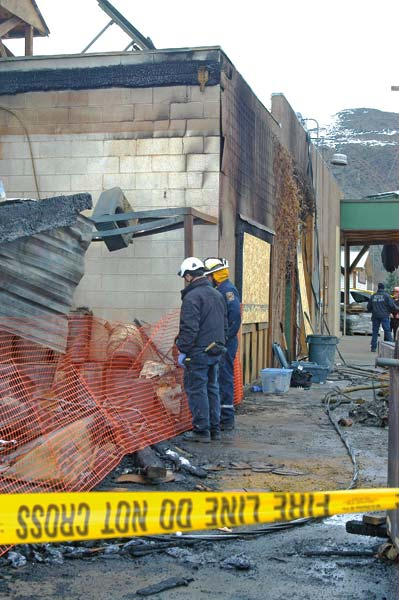 Photo by Ann McCreary Scott Roberts, left, a private investigator working for Mutual of Enumclaw, and Brian Brett, Douglas County fire marshal, examine damage at the Twisp River Pub as part of separate investigations into the Feb. 29 fire that caused extensive damage.
