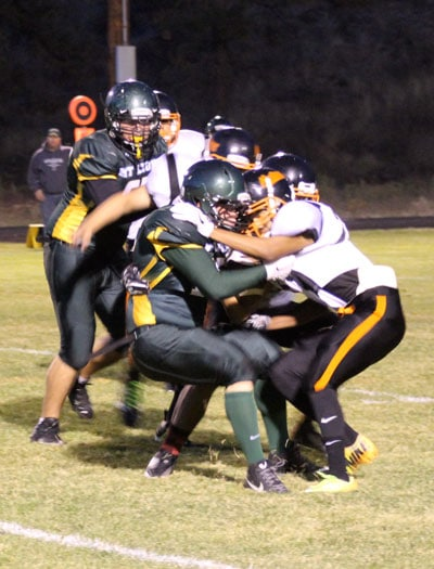 Photo by Don Nelson Mountain Lion defenders converged on a Bridgeport ball carrier at Friday's game.