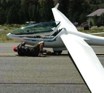 Weighing less than 1,000 pounds, a single-seat glider lifts quickly off the runway behind the tow plane.