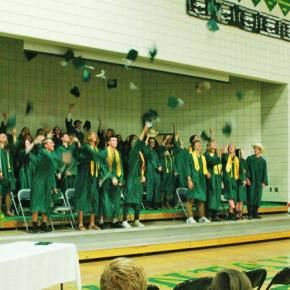 Photo by Darla Hussey Cowboy hats and mortar boards flew high once senior class president Danny Rodriguez turned his tassel.