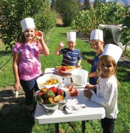 Photo courtesy of Classroom in Bloom Local foods are featured at the  garden party.