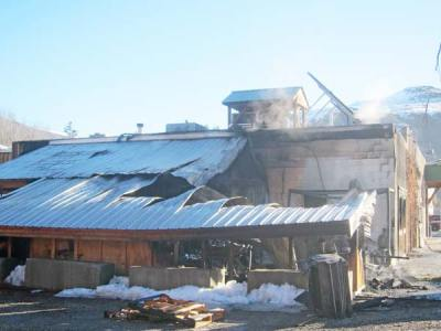 Photo by Don NelsonA few wisps of smoke still hung over the extensively damaged Twisp River Pub on Monday morning.