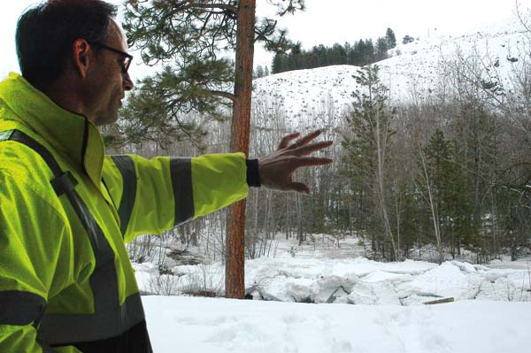 Photo by Ann McCreary Standing on the west side of the Twisp River where it curves past the town park, Andrew Denham, Twisp public works supervisor, points toward ice chunks that remained along the river banks this week after a large mass of ice temporarily dammed the river near the Highway 20 Bridge.