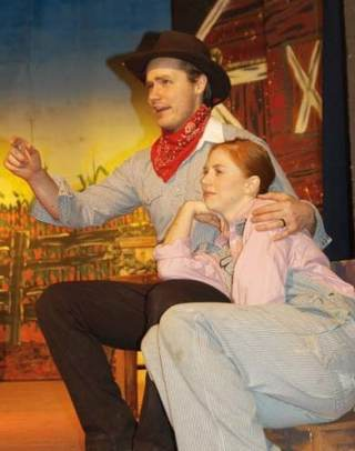 Photo by Ann McCreary Jeremiah Wicken as Curley and Maggie Wicken as Laurie play the lead romantic roles in Oklahoma!