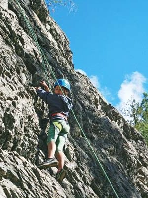 Photo by Marcy StamperSeventh-grader Mia Headlee made good progress ascending the sheer rock face.