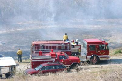 File photo by Mike Maltais Firefighters from Okanogan County Fire District 6 monitored a prescribed burn on shrub-steppe habitat in 2011.