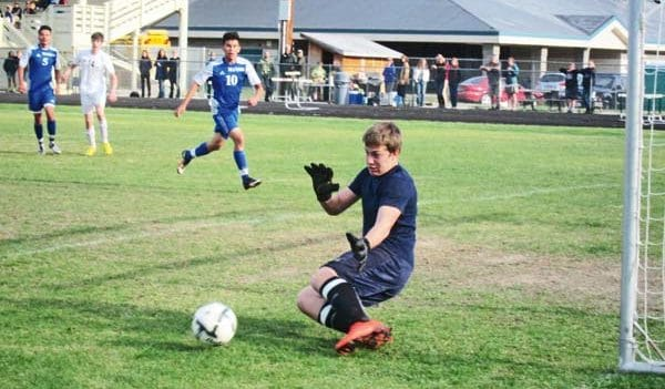 Photo by Don Nelson Liberty Bell goalkeeper Mikey Hafsos made one of his many dramatic saves against Manson.