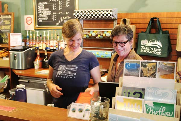 Photo by Don Nelson Employee Alison Gillette, left, and co-owner Christine Janikowksi took care of a customer at Trail's End Bookstore on Monday.