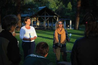 Photo by Don Nelson Molly Patterson, left, and vigil organizer Genessa Krasnow observed a moment of silence for victims of shootings at the Pulse Nightclub.