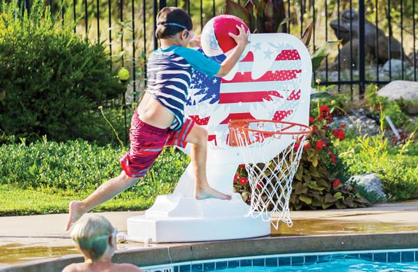 Photos by Mandi Donohue Slam dunks were easy at the Freestone Inn pool party.