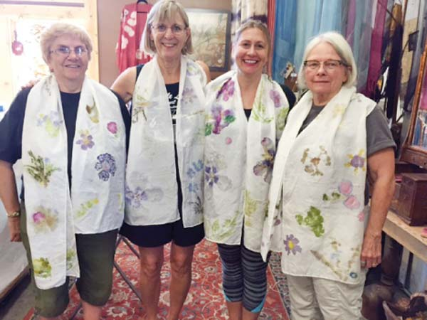 """Photo courtesy of Galen Willett Participants in the """"Art of Victorian Flower Pounding"""" workshop held by Sara Ashford at the Culler Studio, TwispWorks, on Aug. 20: from left, Karen Dahl of Winthrop, Gaylen Willett of Chelan, Grace Hockley of Entiat and Sam Edmunds-Owen of Winthrop."""