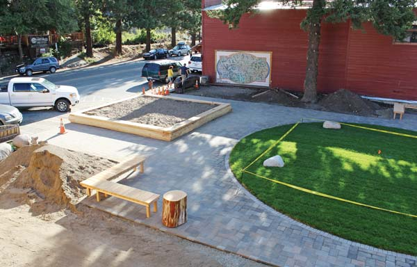 Photo by Don Nelson Benches, landscaping and paving stones are part of the design for Confluence Park in downtown Winthrop.