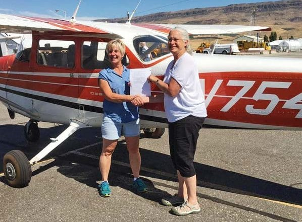 Photo courtesy of Randy Rantz Louise Bighouse, left, recently realized her lifelong dream of obtaining a private pilot's license. With her was FAA examiner Judith Kirkwood.