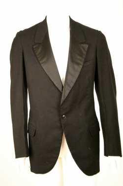 C. 1940s Black wool tuxedo jacket. Single button single breasted.