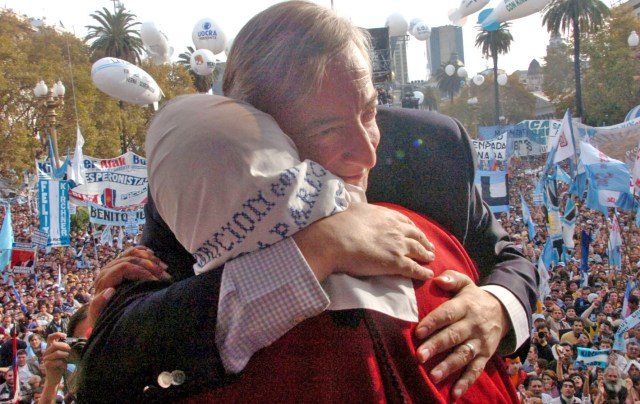 In this picture released by Government Palace, Argentina's President Nestor Kirchner embraces Hebe de Bonafini, leader of the human rights group Mothers of Plaza de Mayo, before addressing to tens of thousands of supporters filling Buenos Aires Plaza de Mayo, Thursday, May 25, 2006, during a rally marking Kirchner's third anniversary in power, a move seen by many as a tune up for a re-election run next year. (AP Photo/Presidencia de la Nacion,HO)