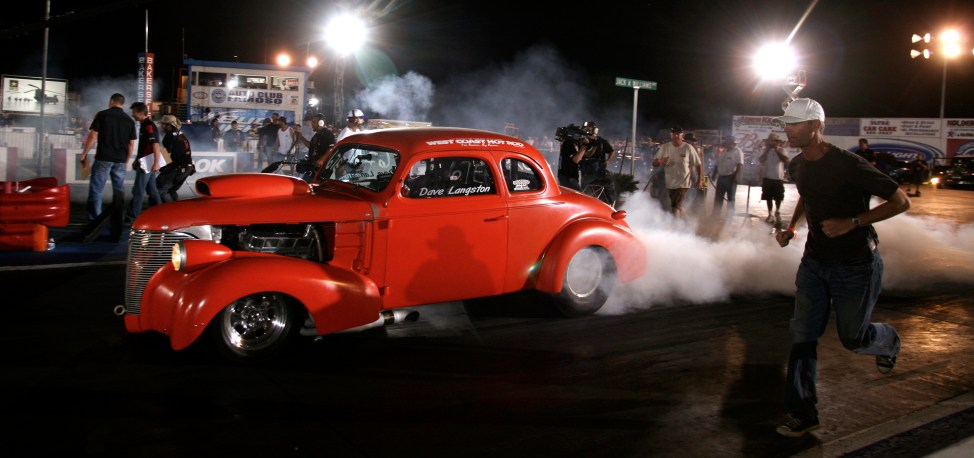 Dave Langston and his '39 Chevy and crew peal out onto the raceway during the filming of the TV show 'pinks' at Famoso Raceway, 2009. - The Bakersfield Californian