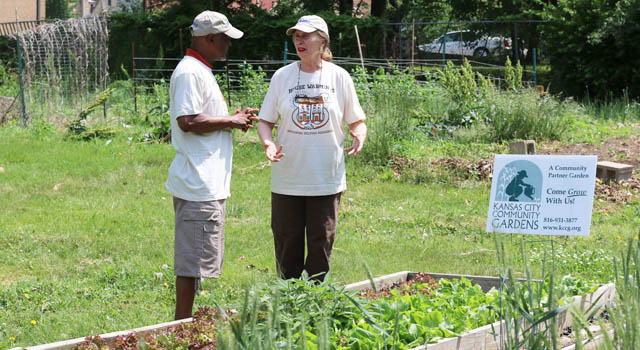 Susan Lackamp and Larry Thompson look over the community garden in  the Manheim neighborhood.