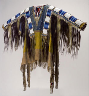 Man's Shirt, Oglala Lakota (Teton Sioux) artists, South Dakota, 1865. Native tanned leather, pigment, human hair, horsehair, glass beads, porcupine quills, 58 x 42 ½ inches. Buffalo Bill Center of the West, Adolf Spohr Collection, Gift of Larry Sheerin, NA.202.598.
