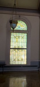 Stained glass windows surround the second floor ballroom, which is now rented out for weddings and other events.