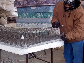 At the Avenue of Life facility, mattresses and box springs are dismantled by hand. Metal, wood, foam, polyester and cotton are reclaimed and sold to manufacturers for making new products. Photo courtesy Mid-America Regional Council.