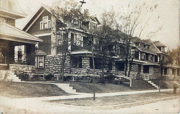 "This neat row of ""modern"" homes sprang up on the 3800 block of Troost around 1910, when C.F. sent this postcard. Today, the homes are gone, but St. Mark's Lutheran Church still stands on the block just north of Arrow Cleaners."