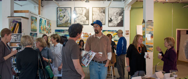 At a recent event in the Crossroads, Alex Hamil (in the baseball cap) talked to fellow artists about the Penn Valley Plein Air Fest and other outdoor painting competitions that offer chances for learning new skills and finding new audiences.