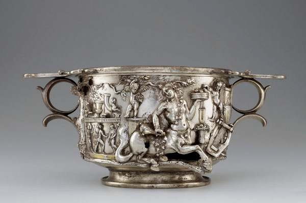 "Courtesy Nelson-Atkins Museum of Art. Offering Bowl with Bacchus, Hercules, and Coins, ""Patera of Rennes,"" Roman, 208-209. Gold, 1 9/16 x 9 13/16 inches, weight: 2.9 pounds. Bibliothèque nationale de France, Département des monnaies, médailles et antiques, Paris."