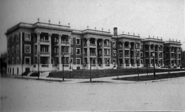 The Colonnade, which stretched along the south side of Armour from Central to Wyandotte, was one of the largest apartments in Kansas City when it was built in 1905. Builder W.H. Collins set a new standard for apartment design for the interior layout and the unusual deep front lawn. Photo from Pen and Sunlight Sketches of Greater Kansas City, 1911.