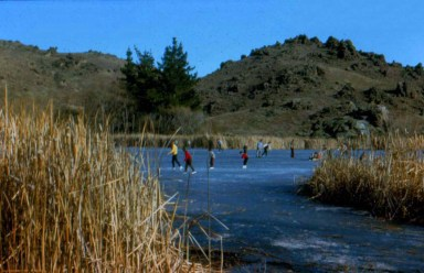 Ice Skating on the Manorburn Dam, near Alexandra, 1970s. Photo: A. Pole.