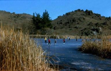 Ice Skating on the Manorburn Dam, near Alexandra, 1970s. Photo: A. Pole.