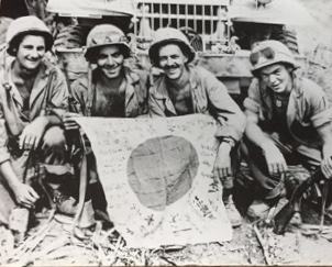 Men of the 1st Provisional Rockets pose with a captured Japanese flag on Iwo Jima. Louis A. Hamilton is second from left (USMC Photo, originally appeared in the Chicago Sun Times)